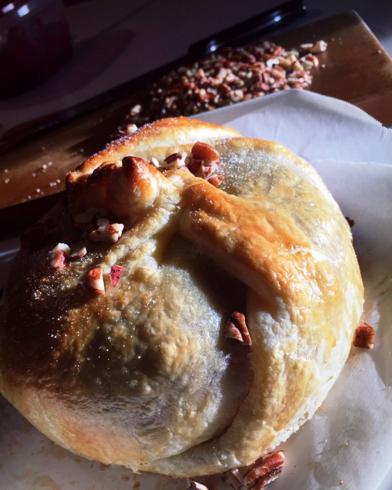 Holiday Baked Brie with Rosemary-Infused Cranberry Sauce topped with pecans and sugar