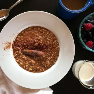 Apple Cinnamon Porridge with berries, milk and coffee