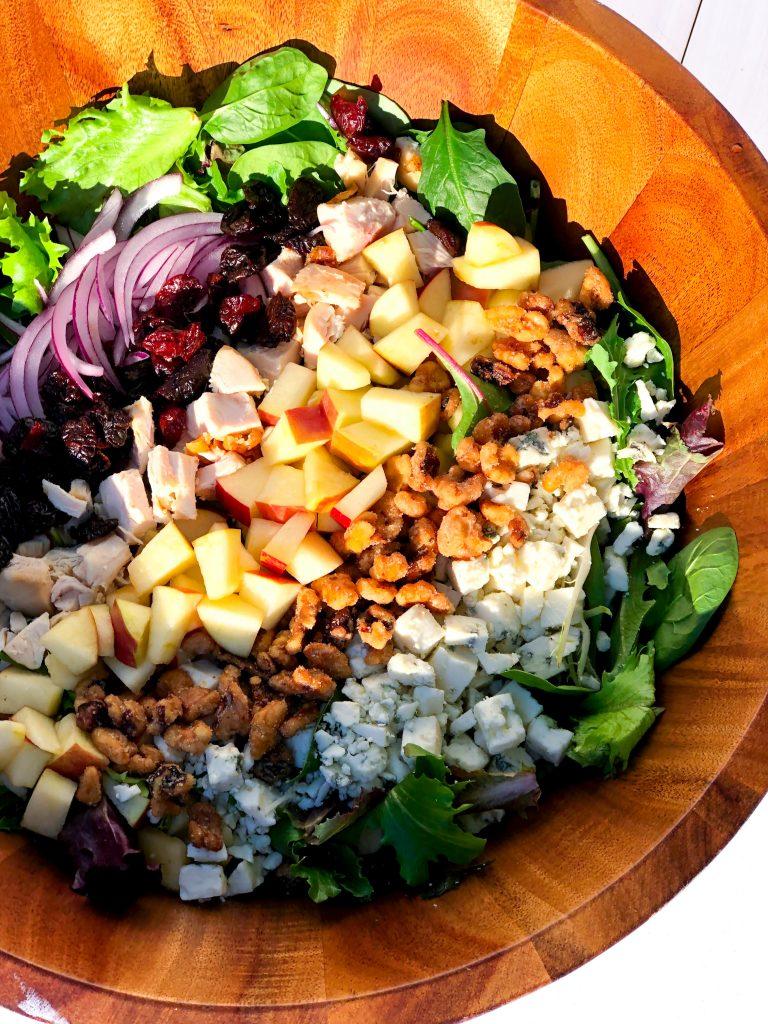 Apple Chicken Harvest Salad in a wooden bowl.